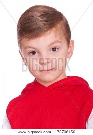 Close up emotional portrait of caucasian little boy. Head shot of handsome child. Funny cut kid looking at camera, isolated on white background.
