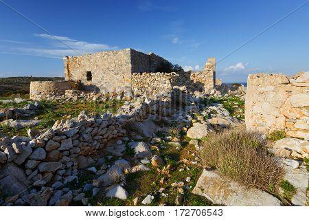 Castle over Livadi beach on Iraklia island in Lesser Cyclades, Greece.