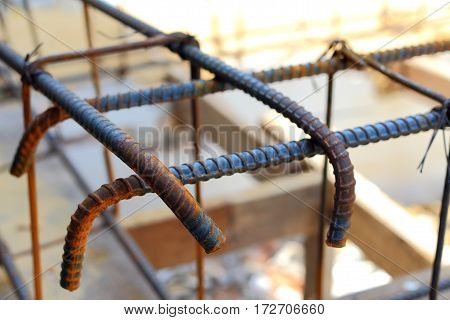 Roll of rusty iron cage for concrete reinforcing. Reinforcing bar background. bundle of reinforced components in a construction site. Iron line Texture.