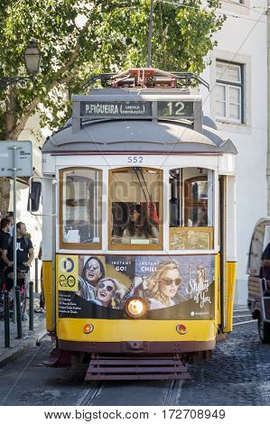 LISBON - PORTUGAL, CIRCA 2016: A Vintage style tram, on route 12, one of the routes that climbs through the steep inclines of the city's old town