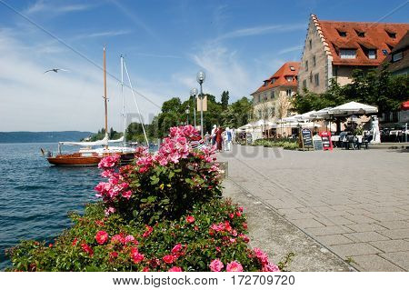 People Walking By The Lake Of Constance At Ueberlingen