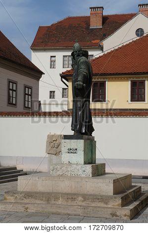 Street of Varazdin, Croatia, with a statue of Grgur Ninski