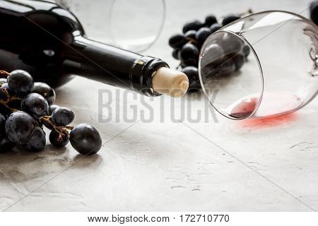 Red wine set for restaurant menu with bottle, glass and grape on texture background