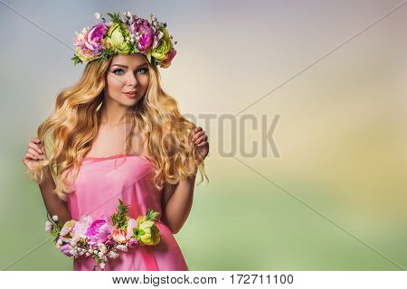 Beautiful young blond woman in flower crown