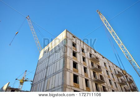 Building house and crane on sky. Element of design.