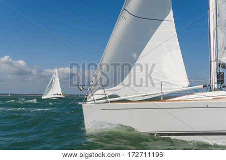 Close up of sailing boat, sail boat or yacht at sea with another white boat in the background