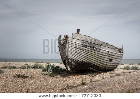 Old wooden boat stranded on a beach