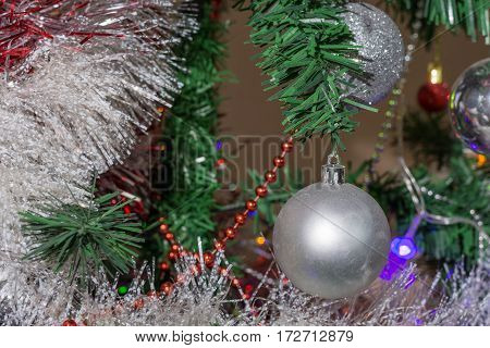 White Decoration Ball On The Christmas Tree