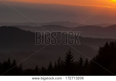 sunset view from mountaintop, sunset over mountain range