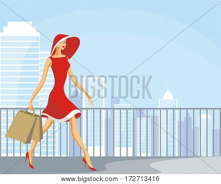 The image of the beautiful young woman with purchases against the background of a city landscape.