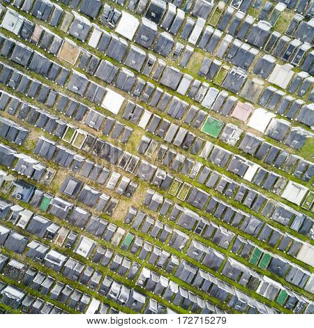 Top-down full-frame aerial view of rows of graves in a crowded North London graveyard - background texture.