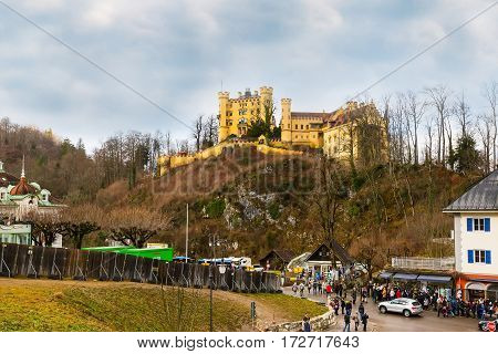 Fussen, Germany - December 27, 2016: Hohenschwangau Castle Schloss on the hill and tourists in Bavaria, Germany