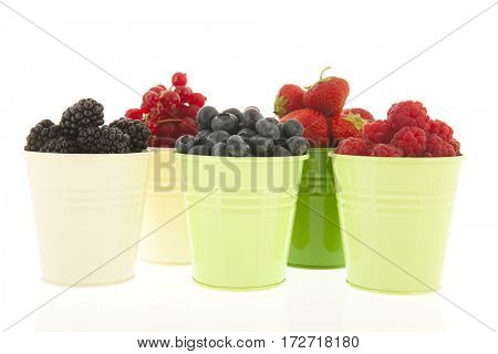 Little buckets with assortment soft fruit isolated over white background