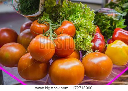 Tomatoes and vegetables at grocery, close up