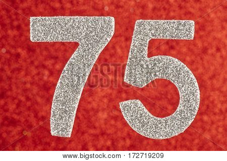 Number seventy-five silver color over a red background. Anniversary. Birthday