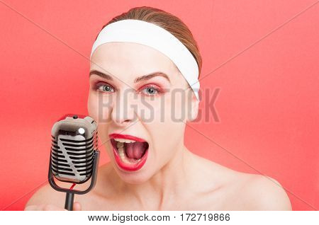 Beautiful Woman With Retro Microphone