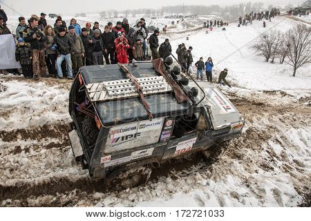 ALMATY, KAZAKHSTAN - FEBRUARY 21 2013: Racing on jeeps car competition. Traditional race