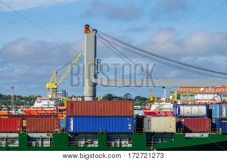 Labuan,Malaysia-Feb 22,2017:Stacked containers on the deck of cargo ship in Labuan port,Malaysia.Its a sheltered deep-water harbour which is an important transshipment point for Brunei Darussalam,Sarawak & Sabah