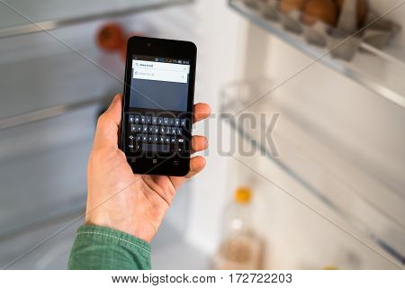 Person Hands Holding Smartphone And Searching For Places To Eat