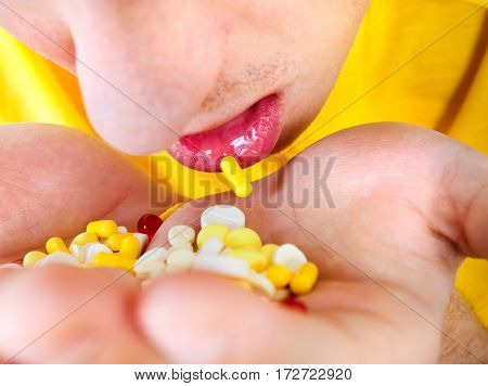 Young Man hold a Pills in the Hands closeup