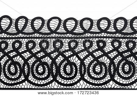 piece of black material with lace on white background