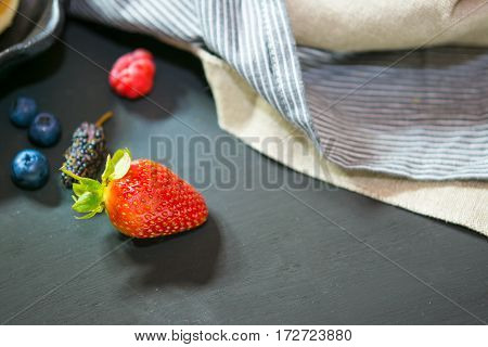 Selective focus strawberry on wood background .