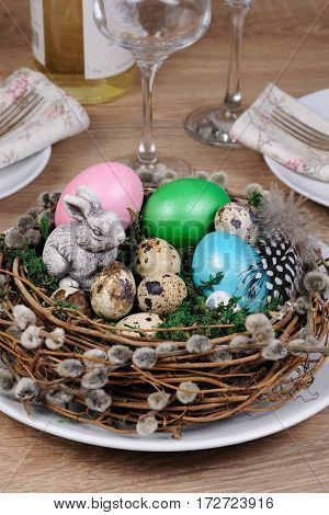 Easter colored eggs scattered on a green moss as an element of a holiday decoration ideas