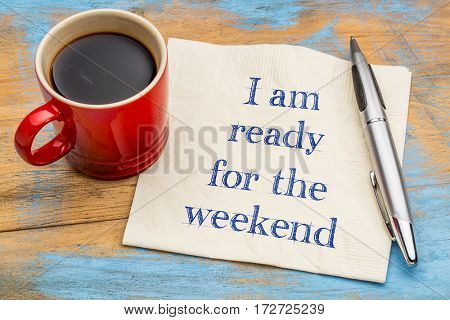 I am ready for the weekend - handwriting on a napkin with a cup of espresso coffee