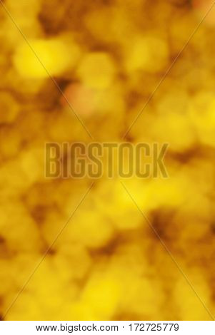 abstract and festive gold bokeh background, blurred lights.