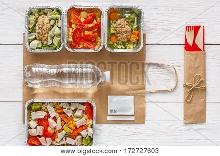 Healthy food delivery. Daily meals set top view in foil containers. Vegetable, fish, meat and fruits, low carb diet