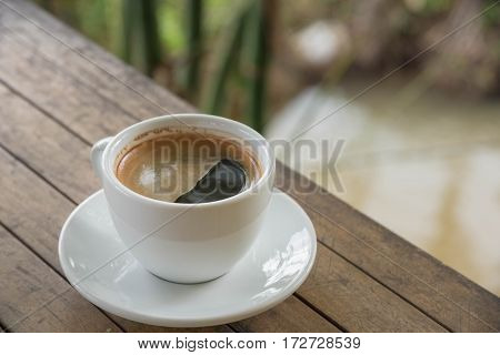 Coffee Cup On Woodden Table