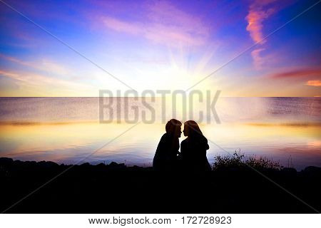Silhouette of couple looking at sunrise : colorful