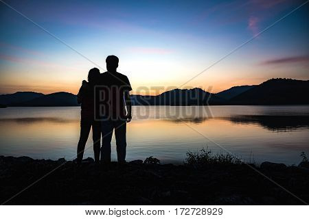 Silhouette Of Couple On The Lagoon