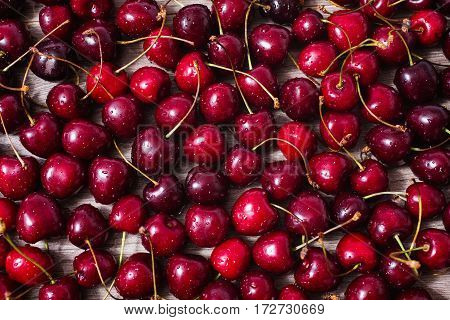 Background of ripe red cherries with water drops. Healthy eating. The texture of berries. Fruit texture