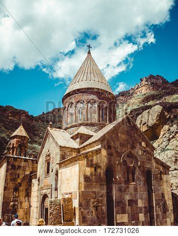 Geghardavank or Geghard monastic complex is Orthodox Christian monastery located in Kotayk Province, Armenia. Armenian architecture. Pilgrimage place. Religion background. Travel concept. Vertical poster