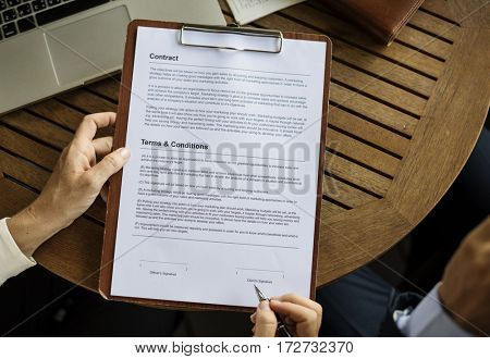 Hands Hold Contract Form Paper Clipboard Business Talk