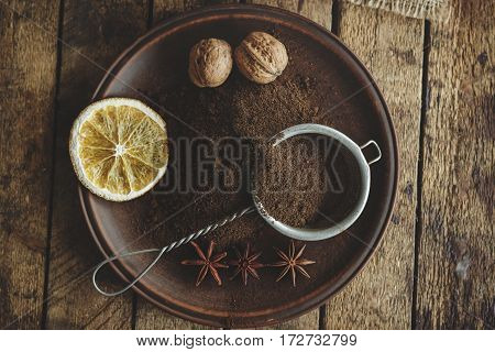 Roasted Coffee Beans And Ground Coffee In The Plate