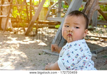 image of little baby look back on nature background