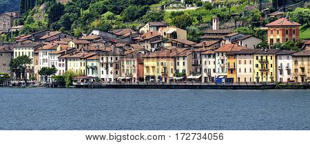 The Ceresio Lake (Ticino Switzerland)) landscape at summer. Santa Maria del Sasso seen from Brusino Arsizio