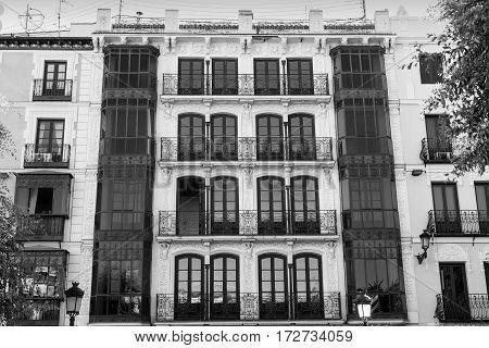 Toledo (Castilla-La Mancha Spain): facade of historic building with balconies and verandas in the Zocodover square. Black and white