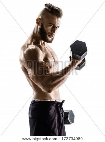 Muscular man doing exercises with dumbbells at biceps. Photo of strong male with naked torso isolated on white background. Strength and motivation.