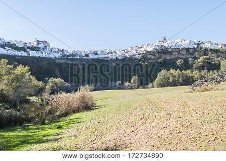 Panoramic of Arcos de la Frontera white town built on a rock along Guadalete river in the province of Cadiz Spain