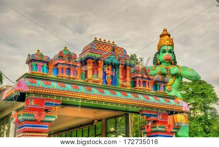 Hindu temple and the statue of Hanuman at Ramayana Cave - Batu Caves, Kuala Lumpur
