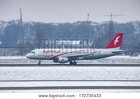 Borispol Ukraine - January 6 2011: Air Arabia Airbus A320 taxiing along the runway for takeoff