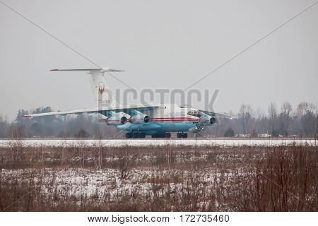Kiev Region Ukraine - February 1 2011: Ilyushin Il-76 cargo plane taxiing along the runway after landing