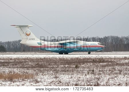 Kiev Region Ukraine - February 1 2011: Ilyushin Il-76 cargo plane taxiing along the runway after landing - side view