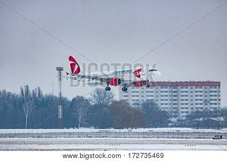 Borispol Ukraine - January 6 2011: Czech Airlines Airbus A320 landing on a winter evening