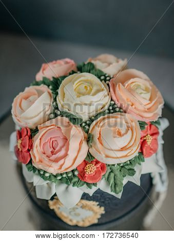 on a black background birthday cake decorated with beautiful roses