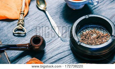 Smokers fashion set with ash tray, pipe and old book