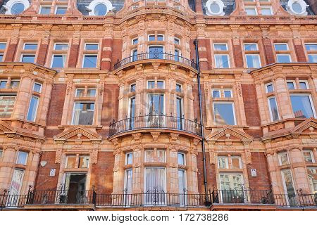 LONDON, UK - FEBRUARY 13, 2017: Red brick Victorian houses facades in Mount Street (borough of Westminster)